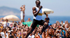 Usain Bolt races on Copacabana beach